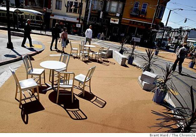 Built Dec 2008, a 7,800 sq ft corner where Castro & Market streets meet, half block of 17th, a turning lane onto Market & a small pediestrian island marked off. Bollards, chairs tables from Ikea, 11 granite slabs at end of streetcar line.
