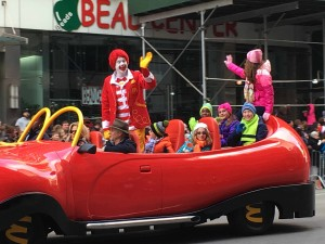 Ronald McDonald, the world's most famous clown, is riding down the Parade route in his one of a kind Big Red Shoe Car.