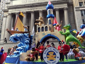 Castle featuring Build a Bear's icon Bearnard, serves as the centerpiece of this adventure themed float.Stars a friendly smoke breathing dragon climbing to see Princess Bear who shows crowd w/ confetti. Tea Party, trip to outer space by Astronaut bear.