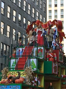 3D calendar on 3 story float kicks off the holiday season w/ showcase of merry scenes behind each day. Mariah Carey Celebrates partnership w/ Hallmark Channel by performing on their float.