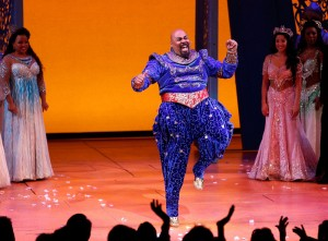"""NEW YORK, NY - MARCH 20:  Actor James Monroe Iglehart takes a bow during curtain call at the the """"Aladdin"""" On Broadway Opening Night at New Amsterdam Theatre on March 20, 2014 in New York City.  (Photo by Jemal Countess/Getty Images)"""